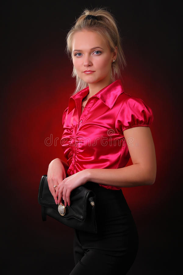 Download Young woman with a handbag stock photo. Image of fluttering - 23064062
