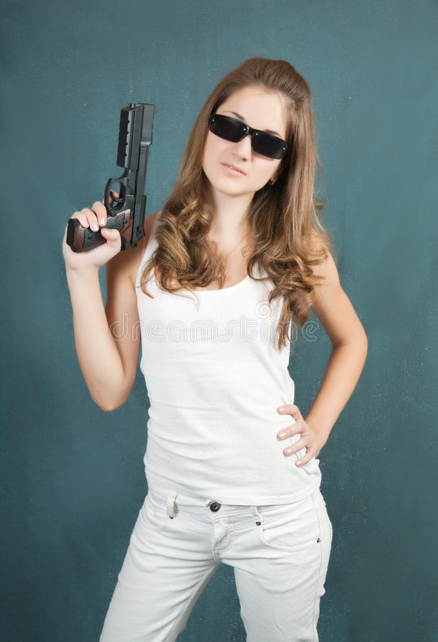Download Young woman  handgun stock photo. Image of background - 13589954