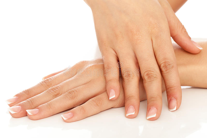 Young woman hands with french manicure stock photography