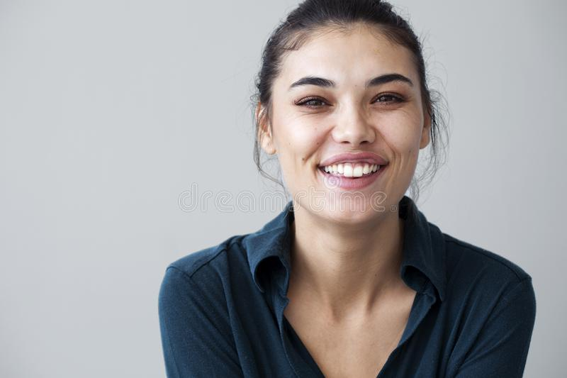Young woman happy on gray background stock photo