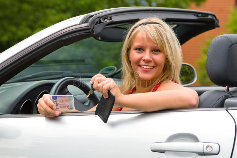 Download Young Woman Happy About Her New Drivers License Stock Photo - Image: 20959344