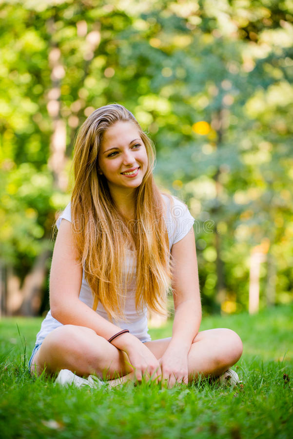 Young woman - happy in nature royalty free stock image