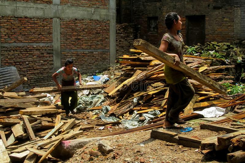 Young woman hard working at the construction in Nepal royalty free stock image