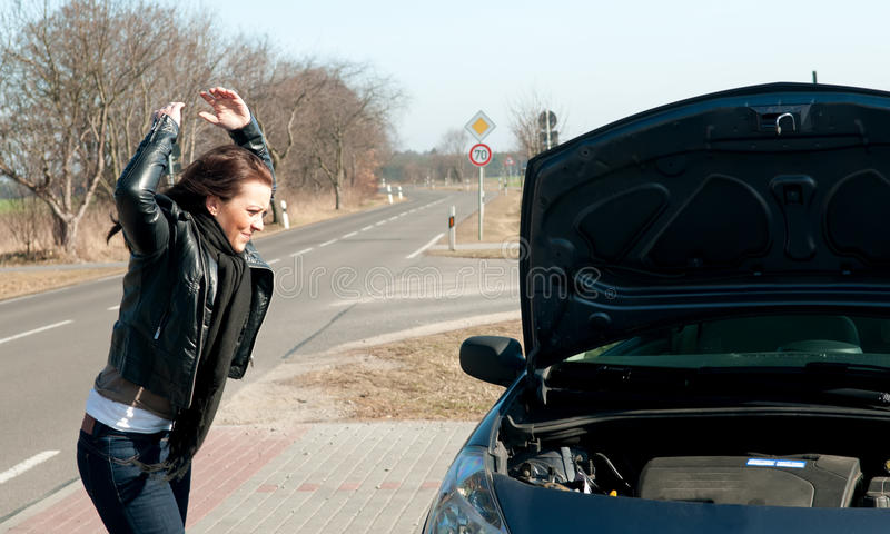 Young Woman Has A Car Breakdown Royalty Free Stock Images
