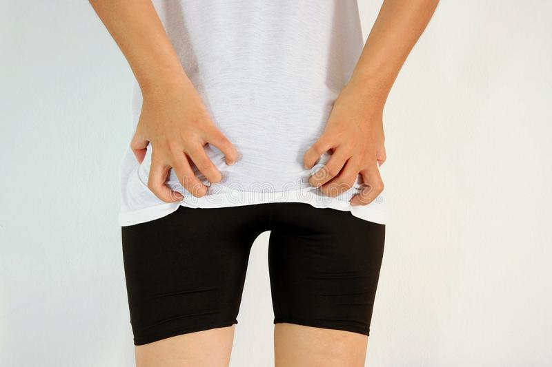 Young woman has itching the buttocks. Healthcare concept stock images