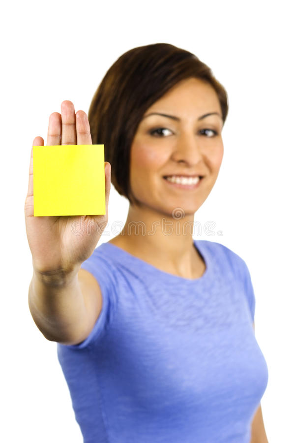 Young Woman Has A Post-it Note Stuck On Her Hand. Royalty Free Stock Photography