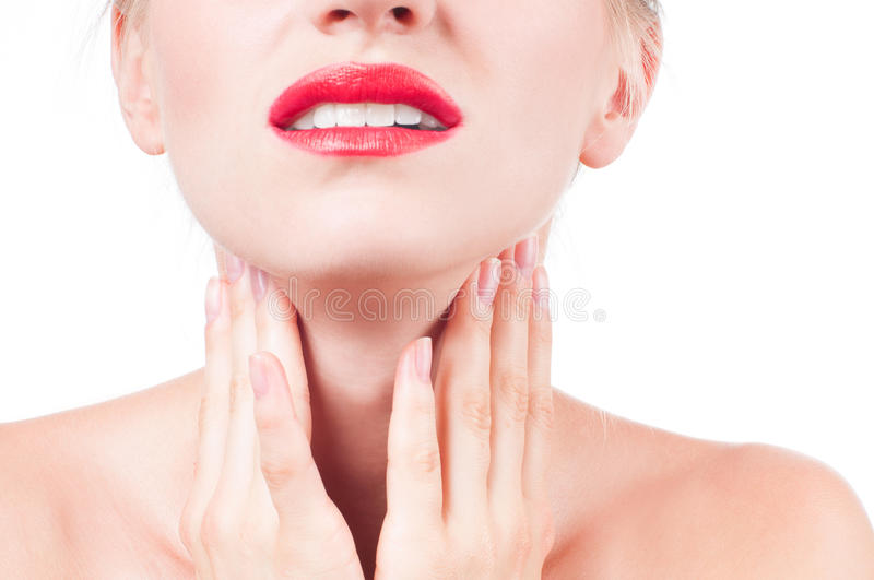 Young woman has sore throat touching the neck stock image