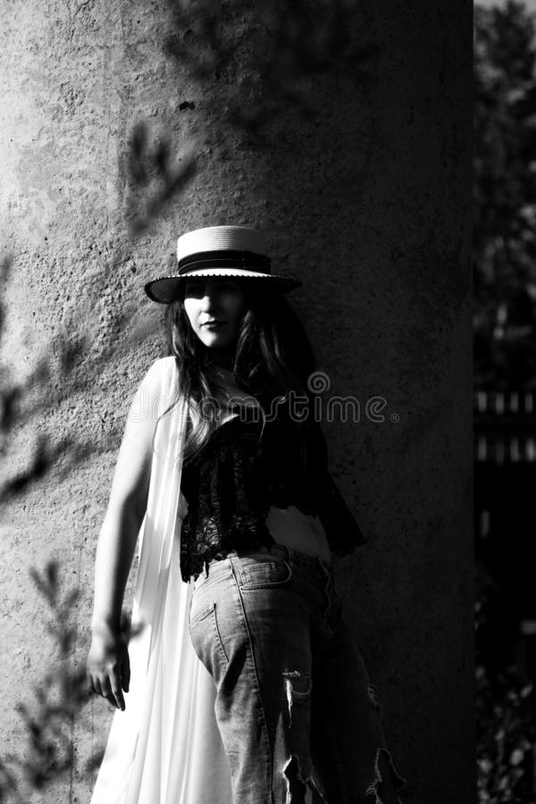 Young woman in the hat walking in the park royalty free stock photo