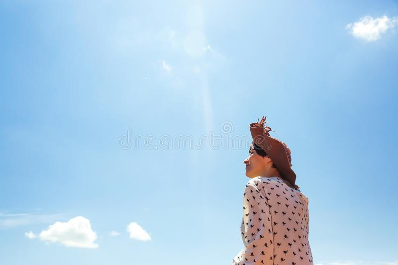 Young Woman in hat enjoying summer time Travel Lifestyle happy emotions  vacations blue sky Smile girl tourist walking stock images