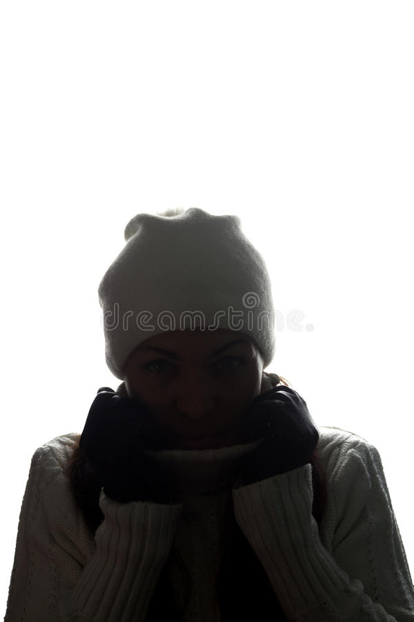 Young woman in hat and gloves look ahead - horizontal silhouette stock photo
