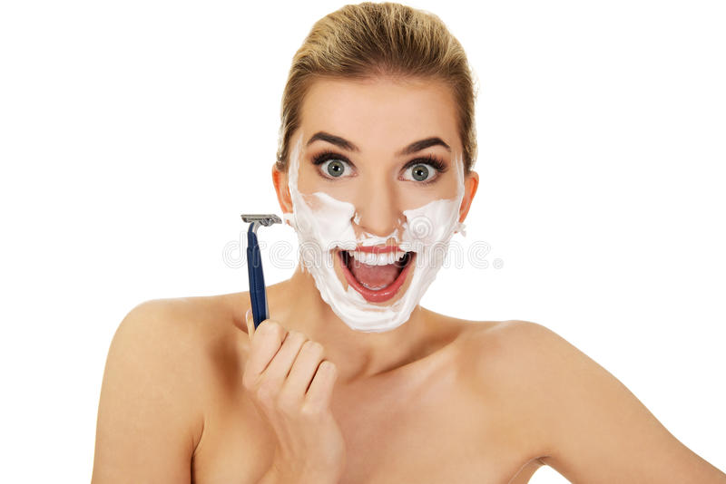 Young woman have morning shave. stock images