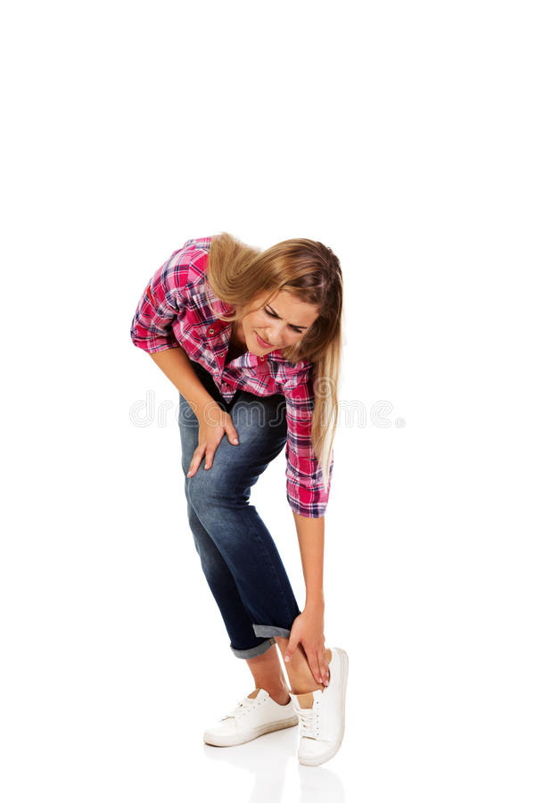 Young woman having ankle pain royalty free stock photography