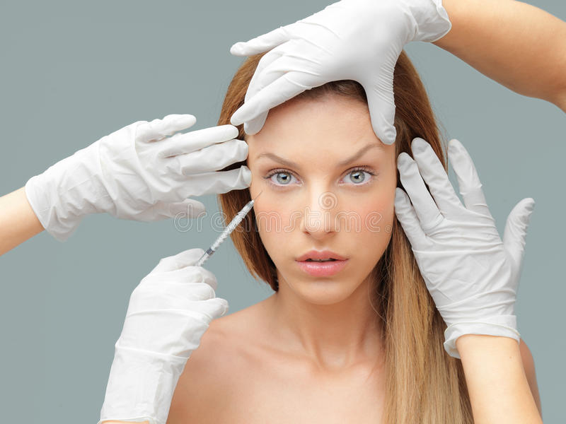 Young woman having botox injection royalty free stock photos