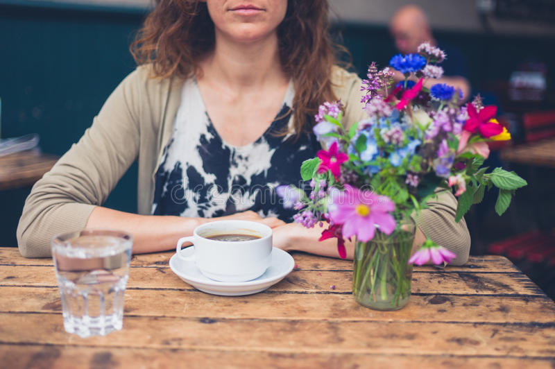 Young woman having coffee in cafe stock photo
