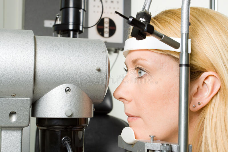Young woman having eye test royalty free stock images