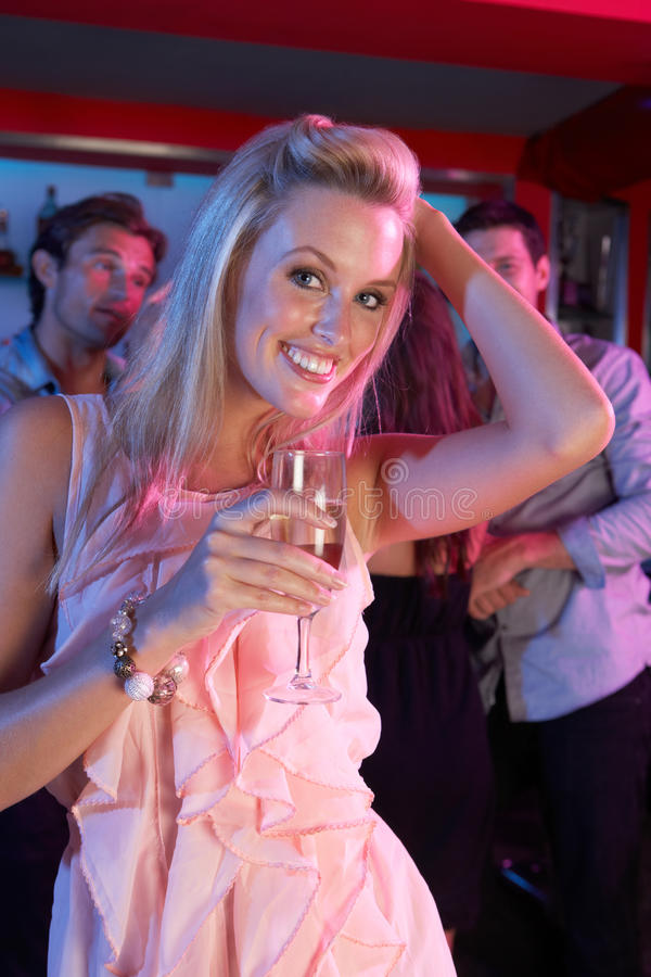 Young Woman Having Fun In Busy Bar royalty free stock images