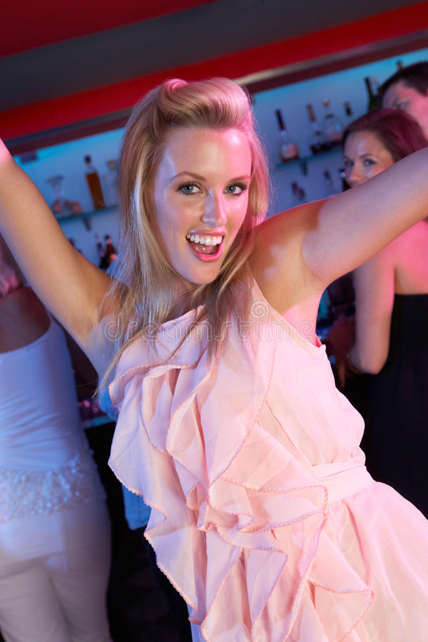 Young Woman Having Fun In Busy Bar royalty free stock image