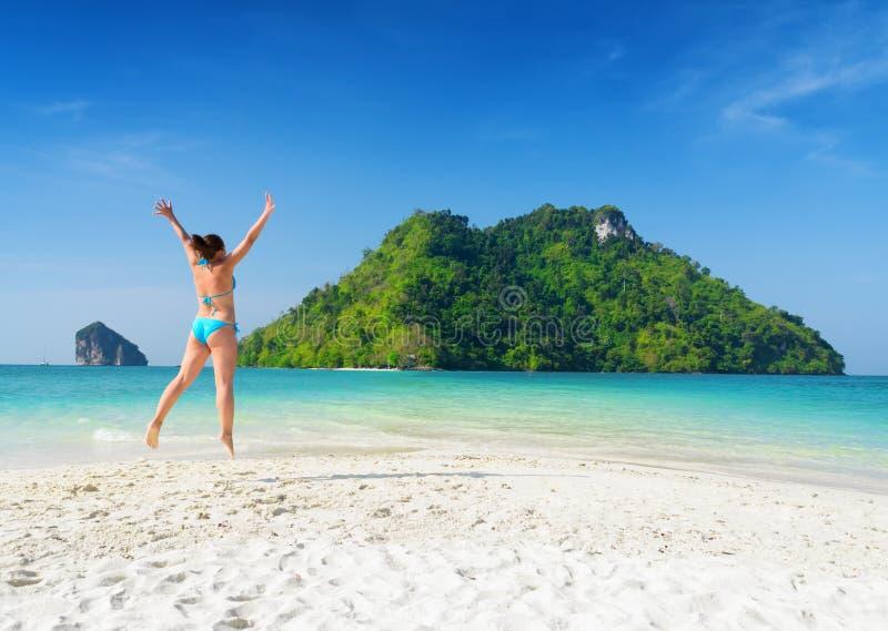 Young woman is having fun on sandy beach