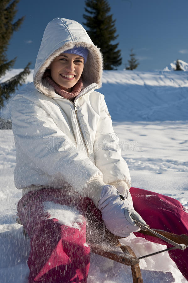 Download Young Woman Having Fun With Sled Stock Photos - Image: 27529003