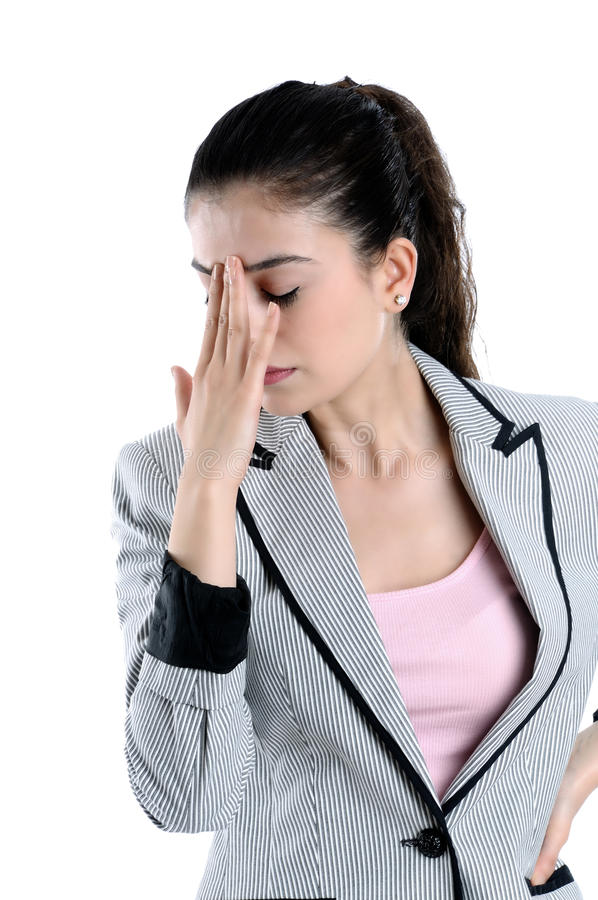 Young woman having a headache. Young pretty caucasian woman having a headache royalty free stock images