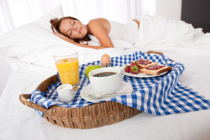 Young woman having home made breakfast. In bed, sleeping stock photos