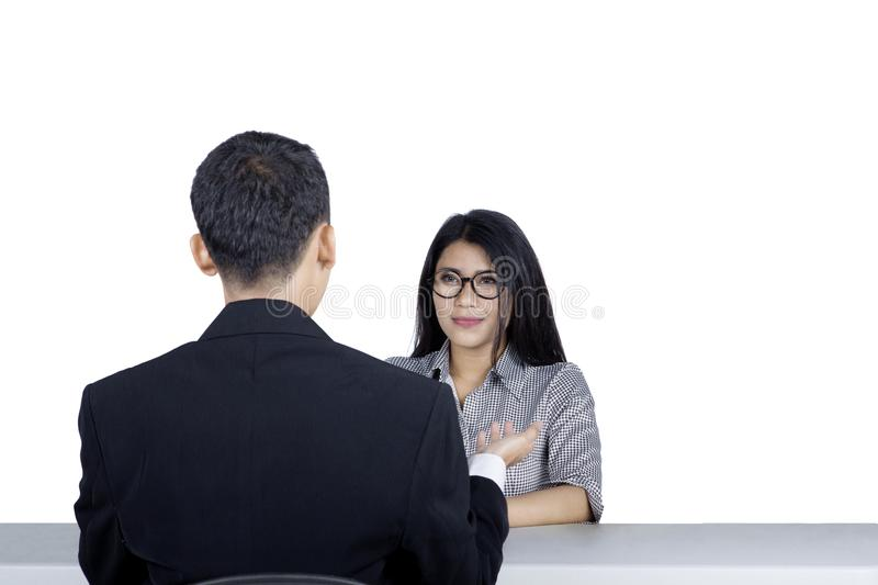 Young woman is having job interview on studio royalty free stock image