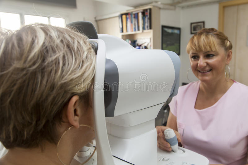 Young woman is having a medical examination at the optometrist. Young women is having a occular hypertension control by pachymetry test at the optometrist royalty free stock photography