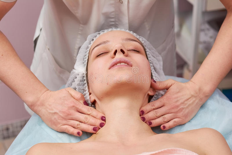 Young woman having neck massage. stock images