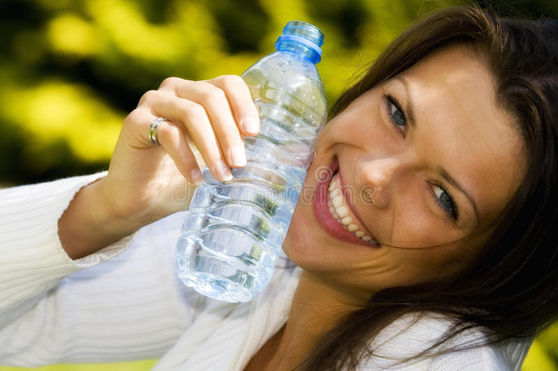 Young woman having a nice time outdoor stock photography