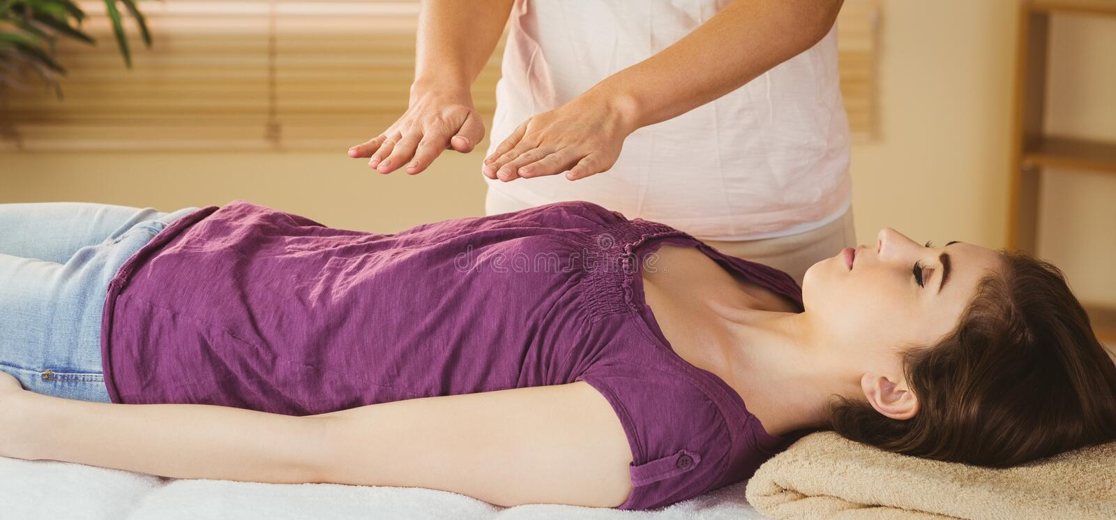 Young woman having a reiki treatment royalty free stock photos