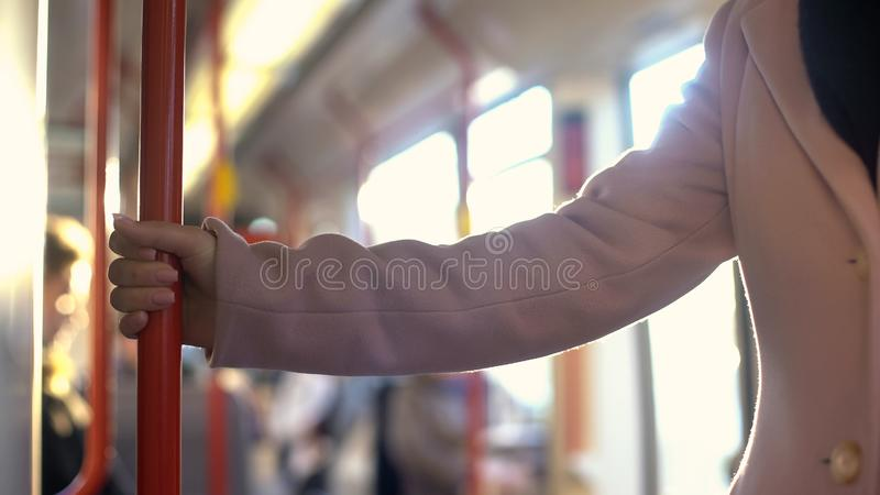Young woman having ride in subway carriage, everyday commuting routine, railroad. Stock photo stock photos