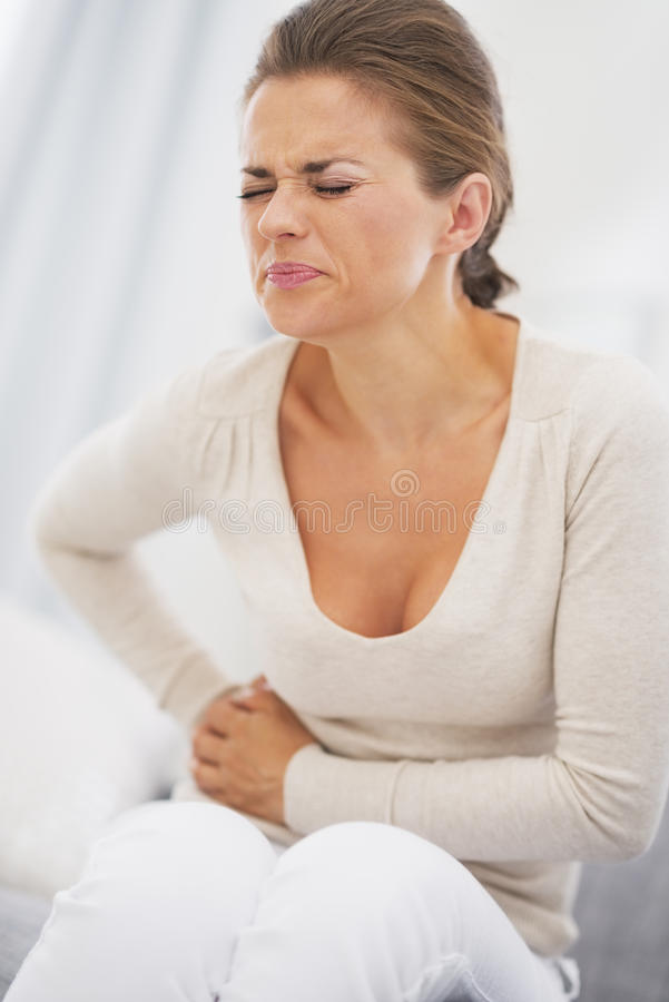 Young woman having stomach pain