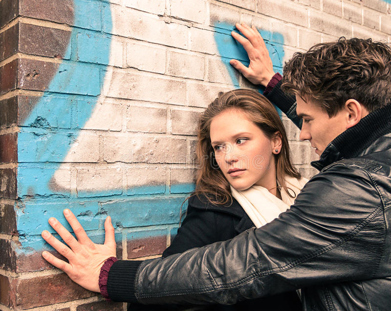 Young woman having trouble with a man. Dramatic moment with a young women having trouble with a man royalty free stock photography