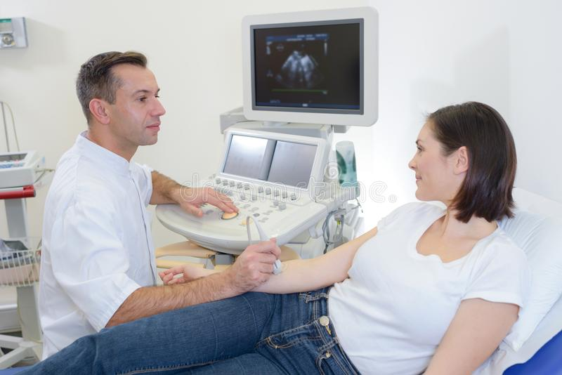 Young woman having ultrasound on forearm royalty free stock image