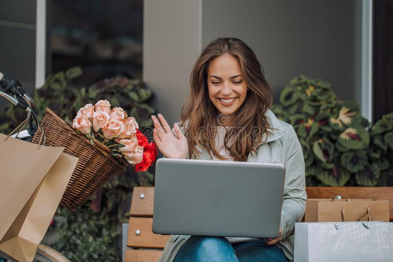 Young woman having a video call with a laptop royalty free stock photography