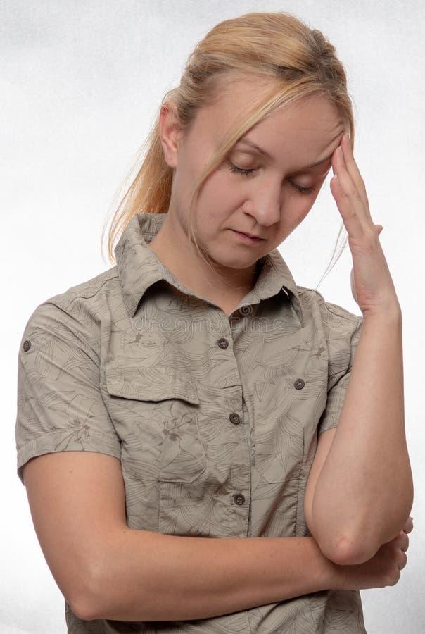 Young woman with a headache stock photos