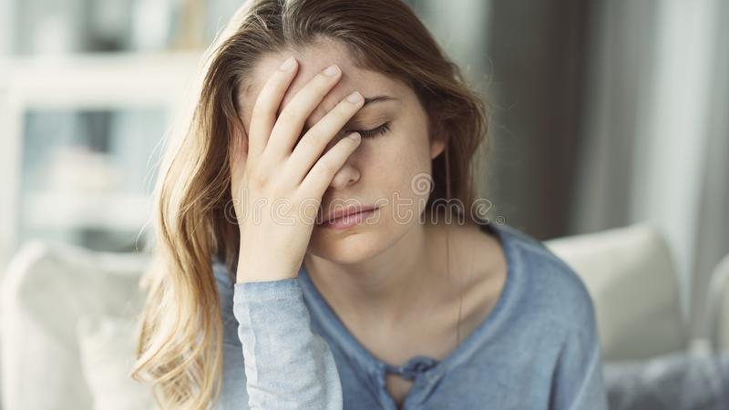 Young woman with headache. Young beautiful woman with headache royalty free stock images