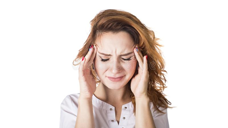 A young woman with a headache holding head, isolated on white background stock photography