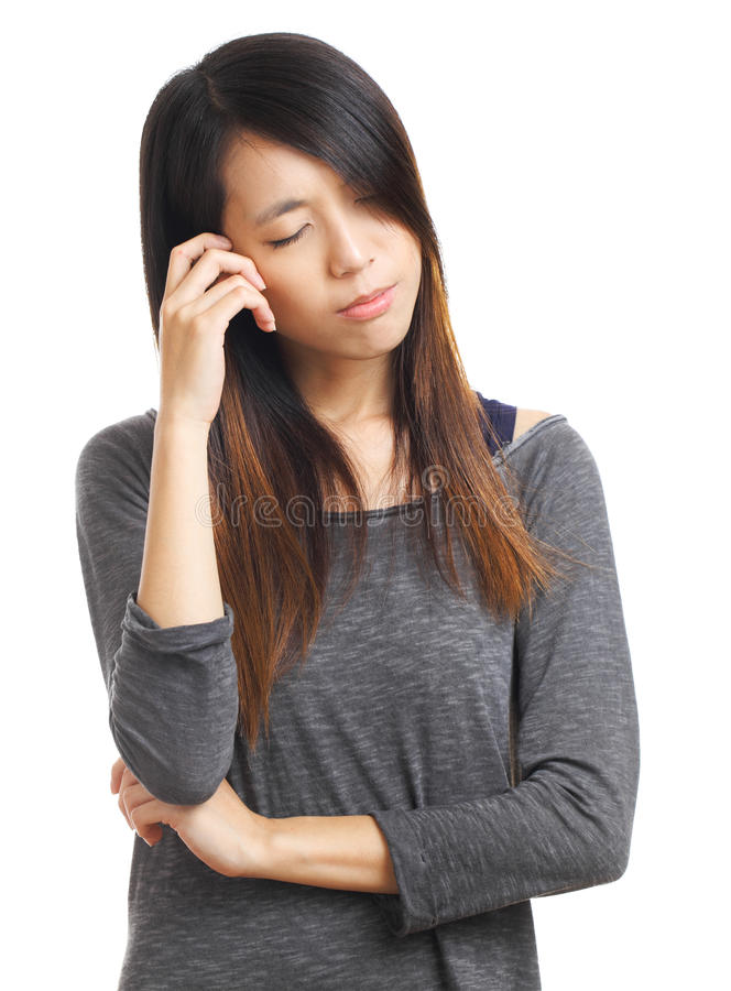 Young woman with headache holding head royalty free stock photography