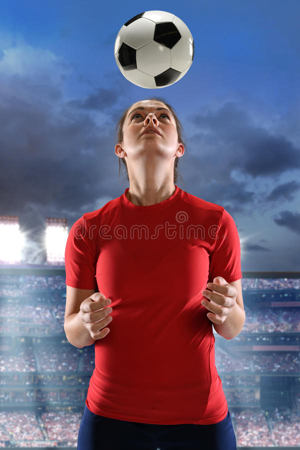 Download Young Woman Heading Soccer Ball Stock Image - Image: 91723611