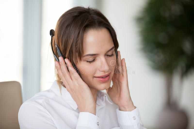 Young woman in headphones enjoying pleasant good music for relax royalty free stock photos