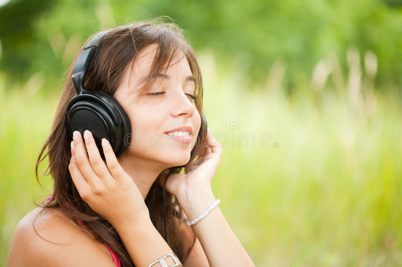 Young woman with headphones outdoor stock photos