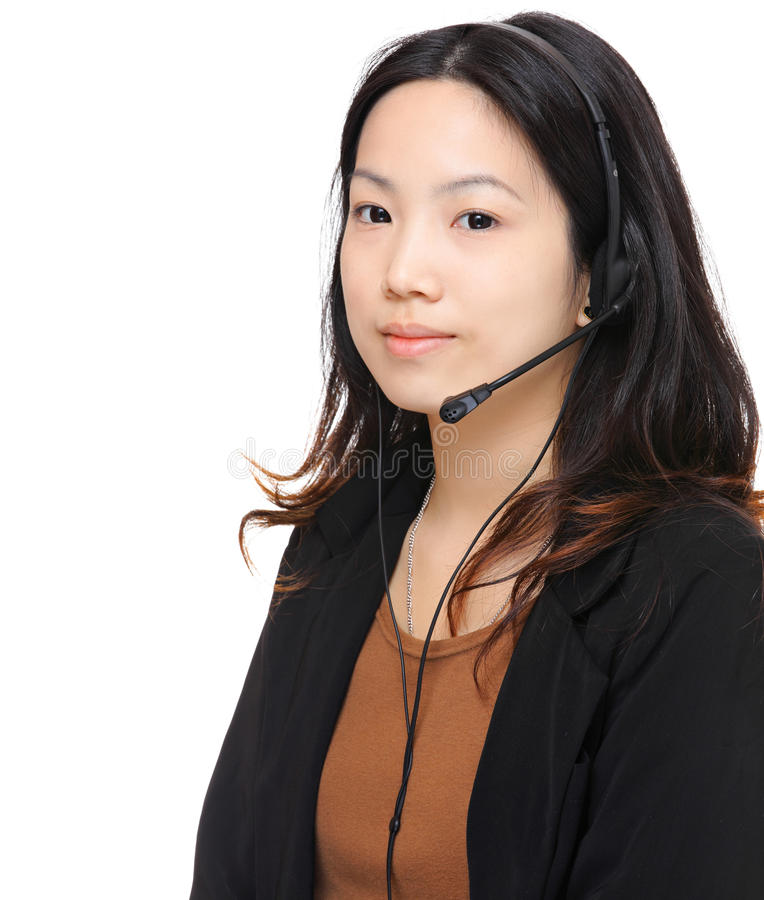 Young woman with headset. Over white background royalty free stock image
