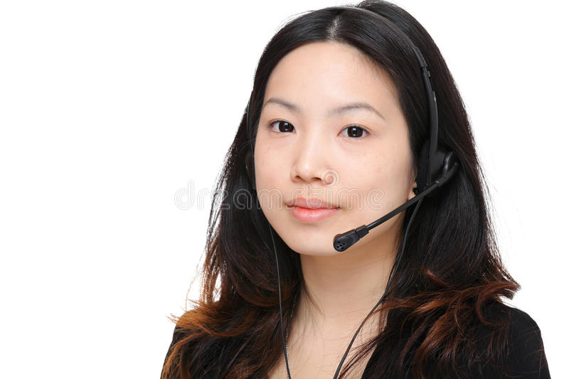 Young woman with headset. Asian woman wearing headset over white background stock photography