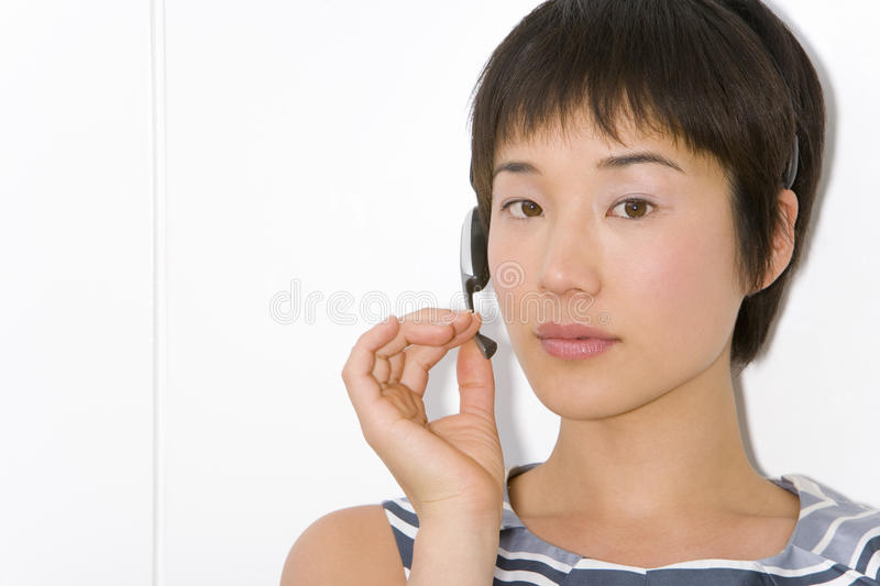 Young woman in headset, close-up. Young women in headset, close-up stock photos