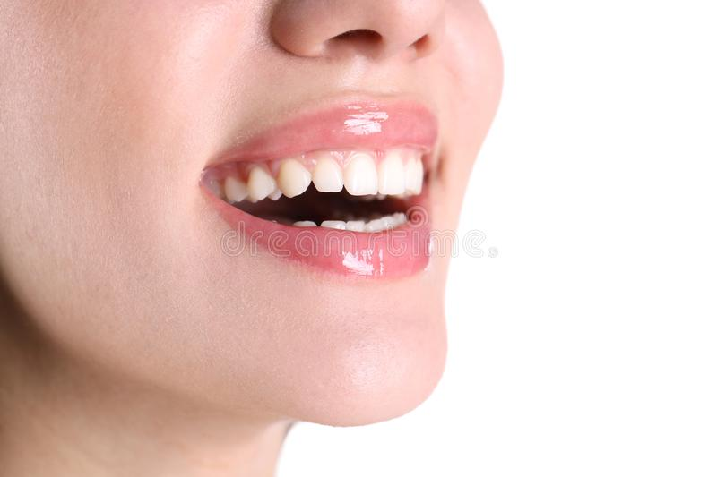 Young woman with healthy teeth smiling on white background. Closeup royalty free stock photography