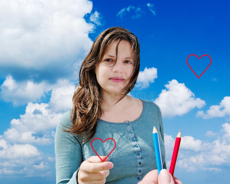 Young woman with heart. stock photos