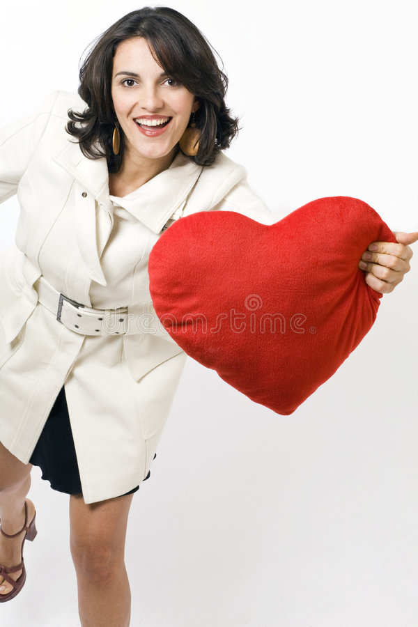 Young woman with heart stock photos