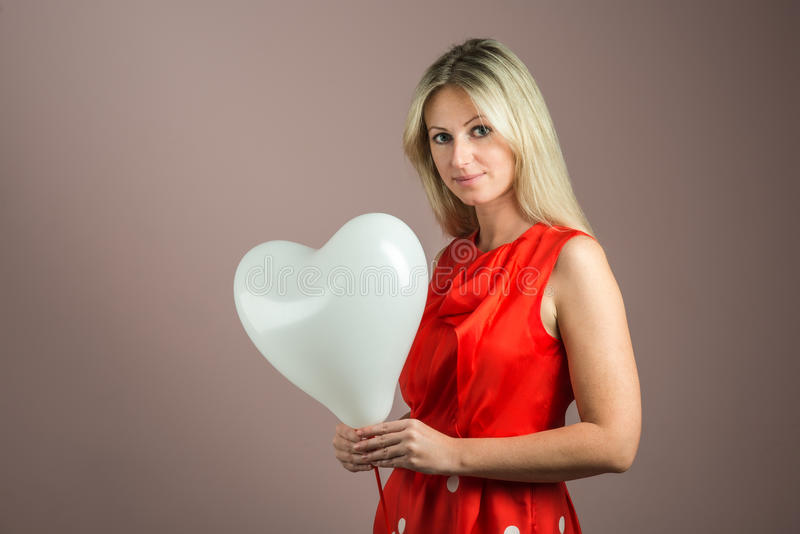 Download Young Woman With Heart-shaped Balloon Stock Photo - Image: 25245702