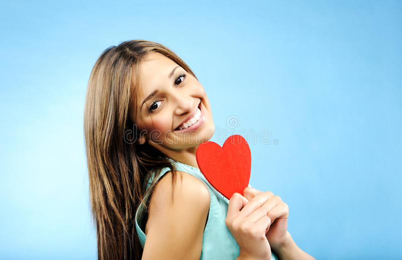 Young woman with heart symbol royalty free stock photos